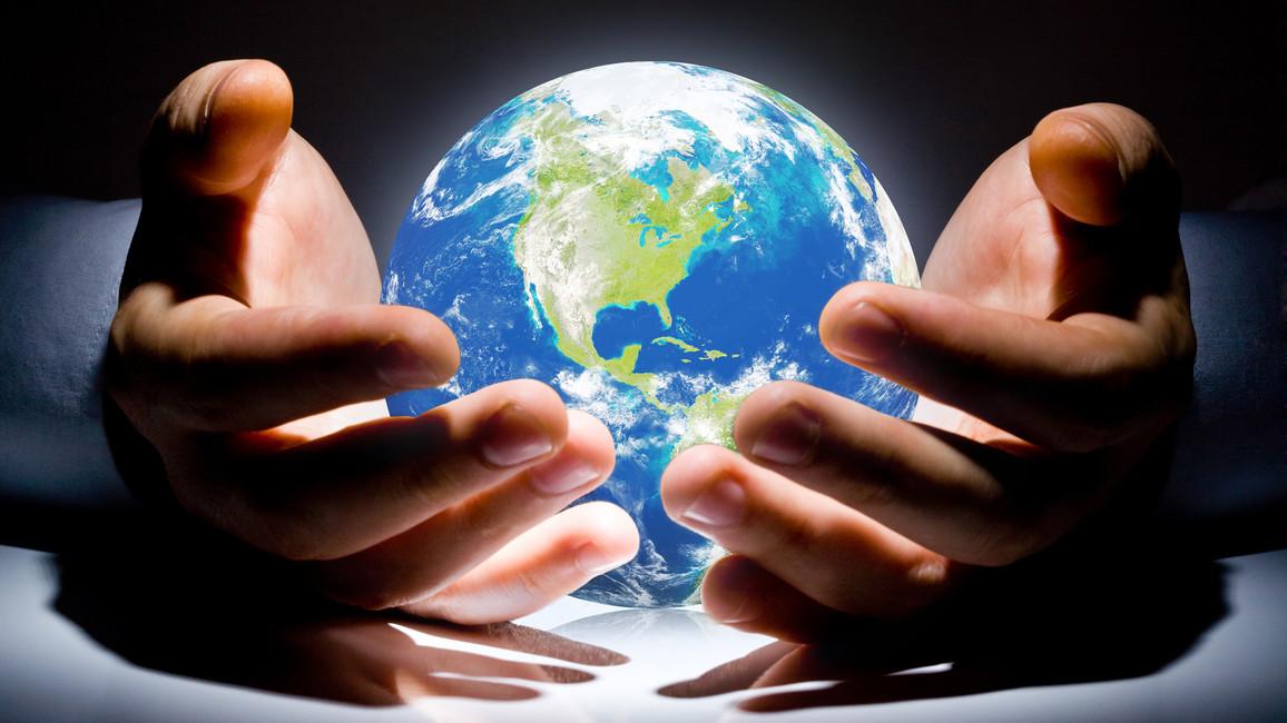 Hände schützen unseren Planeten