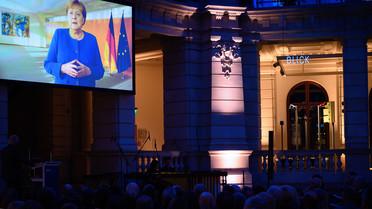 Der Festakt begann mit einer Grußbotschaft von Bundeskanzlerin Angela Merkel.