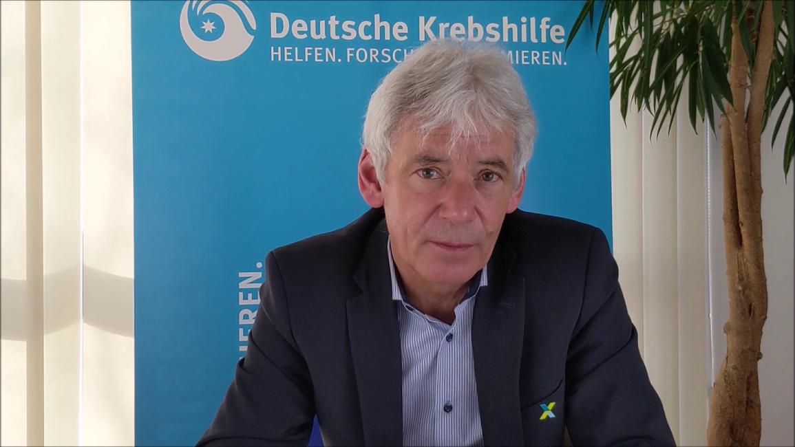 """Poster zum Video """"Zwei Jahre Nationale Dekade gegen Krebs"""" – Gerd Nettekoven"""